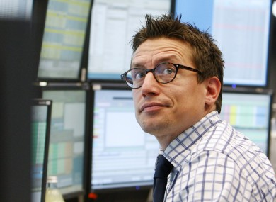 A trader watches his screens at the stock market in Frankfurt, where the DAX index fell below 6,000 points today.