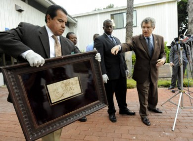 Detectives from the Los Angeles Sheriff's office show the recovered 17th century sketch.