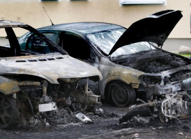 Burned-out vehicles in Berlin, photographed yesterday morning.
