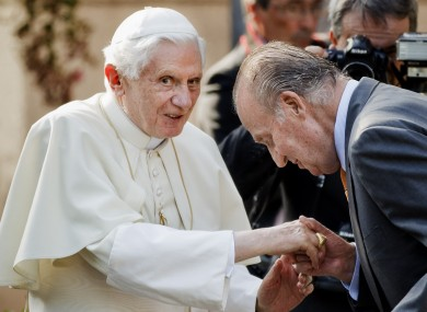 Spain's King Juan Carlos, right, welcomes Pope Benedict XVI before a meeting at the Zarzuela Palace in Madrid.