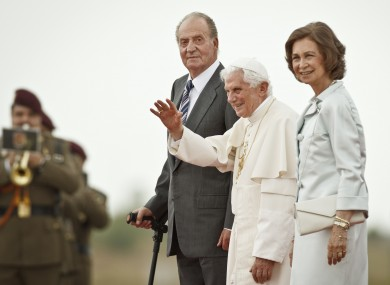Pope Benedict XVI waves while accompanied by Spain's King Juan Carlos and Spain's Queen Sofia before leaving from Madrid's Barajas airport.