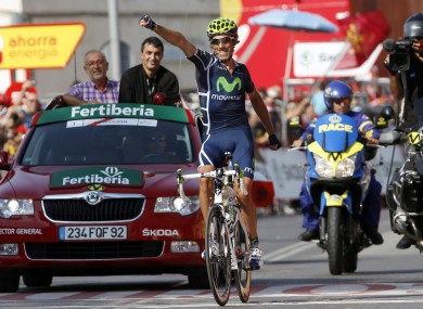 Movistar's Pablo Lastras salutes the crowd as he crosses the line.