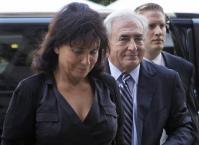 Dominique Strauss-Kahn, centre, arrives at court today with his wife Anne Sinclair.