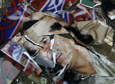 A torn portrait of Gaddafi outside the Libyan embassy in the Philippines earlier this week.