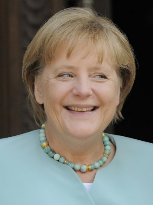 German Chancellor Angela Merkel smiles in front of the state chancellery in Magdeburg, Germany