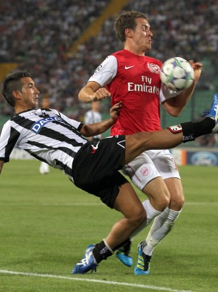 Aaron Ramsey and Giampiero Pinzi in action during Arsenal's 2-1 defeat of Udinese.
