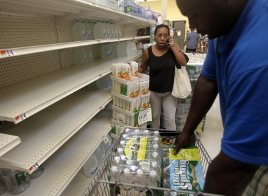 Shoppers stockpile water for the storm in Queens, NYC