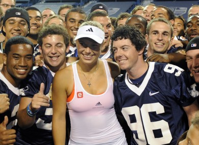 Wozniacki, McIlroy and the Yale football team celebrate her recent victory.