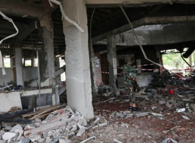 A Nigerian soldier stands in the damaged UN offices after last week's attack.