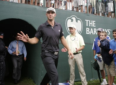 Dustin Johnson emerges back onto the 18th green after signing his score card on Sunday.