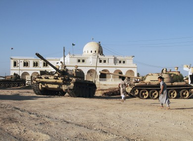 Rebels in Tarhuna, south-east of Tripoli, display tanks they claim to have taken from pro-Gaddafi troops.