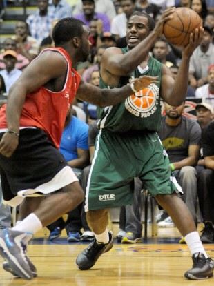 Chris Paul, right, of the New Orleans Hornets, plays against former NBA player Ty Lawson.