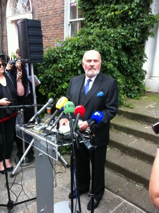 David Norris delivering his statement outside his home today