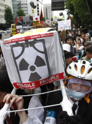 Demonstrators carry a mock coffin during an anti-nuclear power protest,