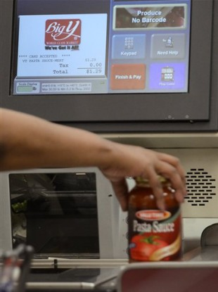 A shopper uses a self-service checkout at a supermarket in Connecticut. Some supermarket chains are beginning to phase out the self-service checkouts, saying they actually slow down the payment process.
