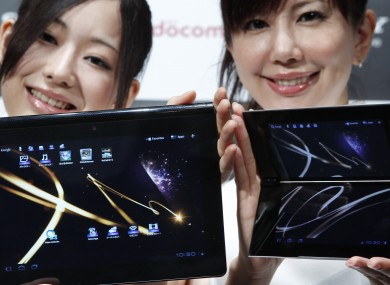 Models show off Sony's new tablet computers, Tablet S, left, and Tablet P during a launch event in Tokyo yesterday.