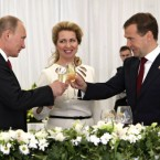 Russian President Dmitry Medvedev, right, Russian Prime Minister Vladimir Putin, left, and Medvedev's wife Svetlana at a presentation ceremony of state awards in the Kremlin in Moscow on June 12, 2011, marking the Day of Russia, a national holiday. (Alexei Nikolsky/AP/Press Association Images)