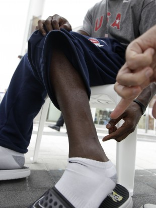 US sprinter Justin Gatlin points to a frostbite scar on his leg during a recent interview