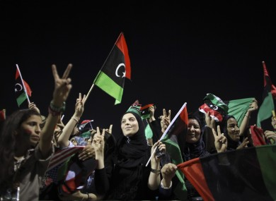Women celebrate the Libyan revolution and call for more rights in the capital of Tripoli on Friday.