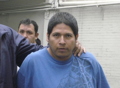 Jorge Antonio Iniestra is led away by police after his arrested on Tuesday.