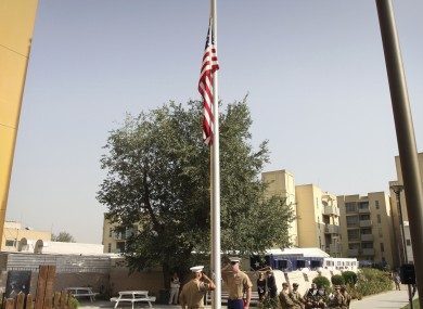 Flags fly at half-mast in the US embassy in Kabul last Sunday. The embassy is among buildings targeted by a Taliban assault today.