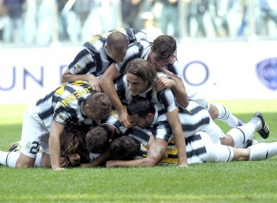 Juventus' players celebrate after Swiss defender Stephan Lichsteiner scores against Parma.
