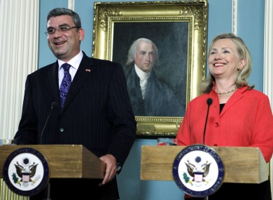 Romania's Foreign Minister Teodor Baconschi with US Secretary of State Hillary Clinton after signing the deal today.