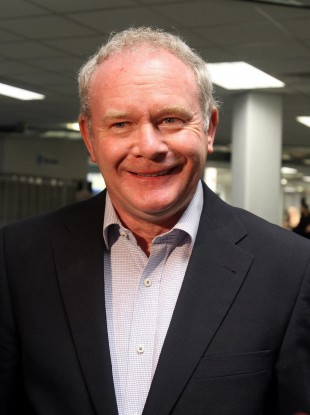Martin McGuinness at Belfast Airport yesterday