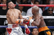 Floyd Mayweather's fiancée predicts fourth-round victory; wins $2,000