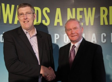 Sinn Fein's Martin McGuinness (right) shakes hands with Northern Ireland's Education Minister John O'Dowd, after Mr McGuinness was announced as the party's candidate for the Irish Presidency