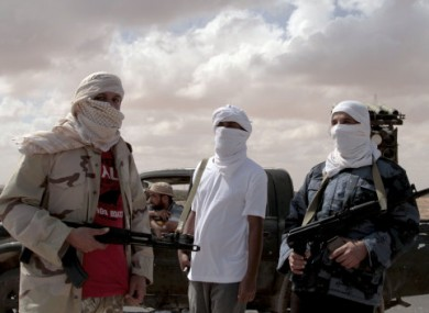 Revolutionary fighters from Sirte guard the western entrance to the city on Thursday.