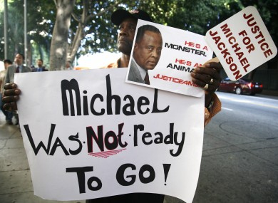 Michael Jackson fan Bristre Clayton, of Las Vegas, stands outside court during the trial of Conrad Murray.
