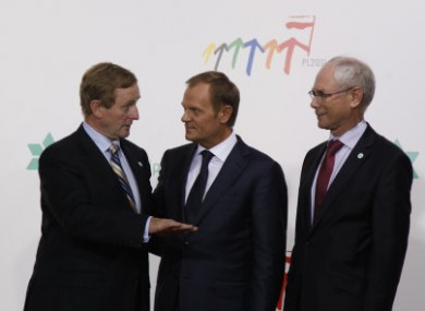 Enda Kenny, left, speaks with European Council President Herman Van Rompuy, right, and Poland's Prime Minister Donald Tusk, centre in Warsaw yesterday
