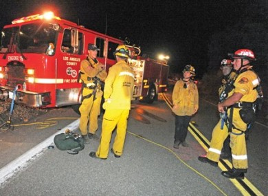 LA County firefighters on Lake Hughes Road in the Angeles National Forest last night.