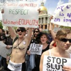 Women march past the Statehouse during the SlutWalk in Boston on May 7.