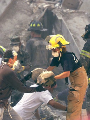 A first responder works in the rubble of the former World Trade Center in New York