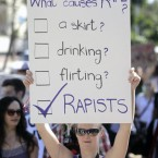 A woman carry a banner during Cape Town's SlutWalk.