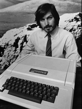 This 1977 file photo shows Apple co-founder Steve Jobs as he introduces the new Apple II in Cupertino, California.