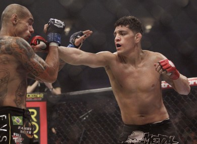 Nick Diaz drives home a strike during his fight with Evangelista Santos in January of this year..