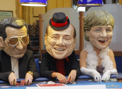 Oxfam activists post as Sarkozy, Berlusconi and Merkel in May 2011.