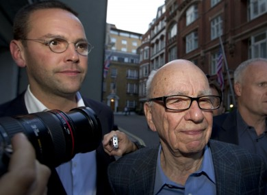 James and Rupert Murdoch outside the latter's house in London in July.