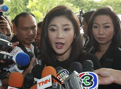 Yingluck Shinawatra talks to reporters