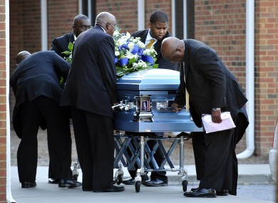 Davis' coffin arrives at the church before his funeral today