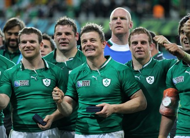 Brian O'Driscoll and his team-mates celebrate after the game.