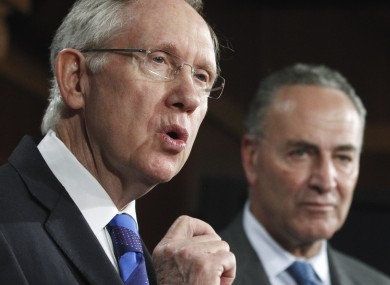 Harry Reid and Charles Schumer address reporters. The Democratic senators have delayed a vote on a bill sanctioning China.