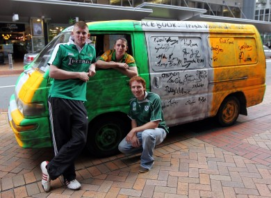 Ireland fans Daniel O'Connor, Daniel McLoughlin and Kebin O'Connor from Donegal with their van that has been signed by members of the Irish team outside the team hotel in Wellington.