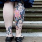 22 year old Beatles fan Linda Tomlinson shows off her tattoos as she waits for the wedding (Jeff Moore/Empics)