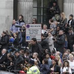 Fans and members of the media wait for the couple to emerge (AP Photo/Lefteris Pitarakis)