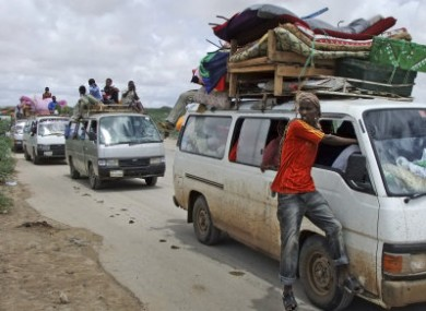 File: Civilians ride on minibuses laden with their belongings as they flee from a district in northern Mogadishu, Somalia, last week