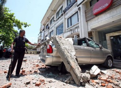 A Mnivan In Kuta Bali Crushed By Falling Concrete During The Earthquake